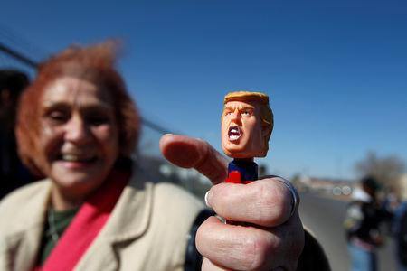 A Trump supporter shows off a doll of U.S. President Donald Trump while waiting to enter El Paso County Coliseum for a rally by President Trump in El Paso, Texas, U.S. February 11, 2019. REUTERS/Jose Luis Gonzalez