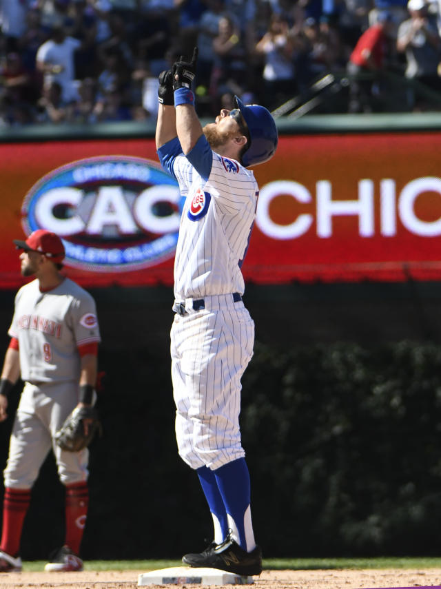 Chicago Cubs' Ben Zobrist (18) reacts after hitting a two-run double against the Cincinnati Reds during the eighth inning of a baseball game Saturday, July 7, 2018, in Chicago. (AP Photo/David Banks)