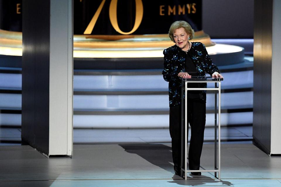 "<p>In 2018, White spoke onstage at the 70th Emmy Awards, and at 96 years old, it doesn't seem like she'll be going anywhere anytime soon. During an interview with<a href=""http://www.cnn.com/TRANSCRIPTS/1007/06/joy.01.html"" rel=""nofollow noopener"" target=""_blank"" data-ylk=""slk:Joy Behar"" class=""link rapid-noclick-resp""> Joy Behar</a>, she said, "" I am the luckiest old broad on two feet if the truth were known.""<br></p>"