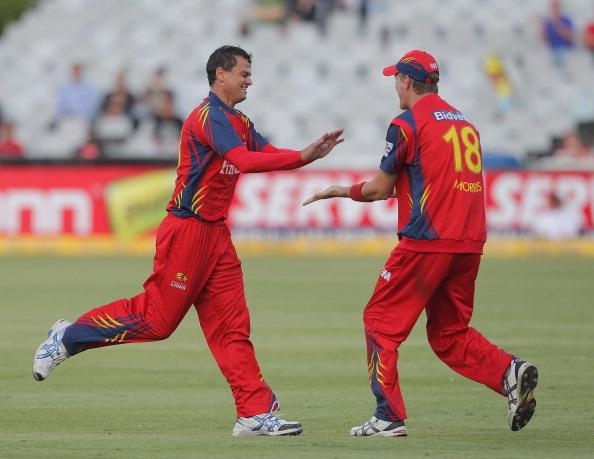 CAPE TOWN, SOUTH AFRCA - OCTOBER 16:  Zander de Bruyn and Chris Morris (R) of the Highveld Lions celebrate during the Karbonn Smart CLT20 match between Chennai Super Kings (IPL) and bizhub Highveld Lions (South Africa) at Sahara Park Newlands on October 16, 2012 in Cape Town, South Africa.  (Photo by Carl Fourie/Gallo Images/Getty Images)