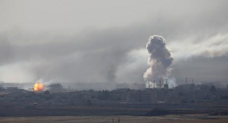Explosion and smoke are seen over the Syrian town of Ras al-Ain as seen from the Turkish border town of Ceylanpinar