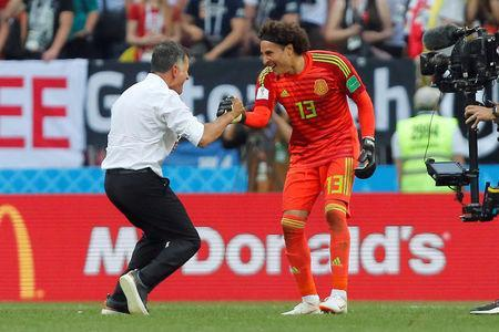 Soccer Football - World Cup - Group F - Germany vs Mexico - Luzhniki Stadium, Moscow, Russia - June 17, 2018 Mexico coach Juan Carlos Osorio celebrates with Guillermo Ochoa at the end of the match REUTERS/Maxim Shemetov