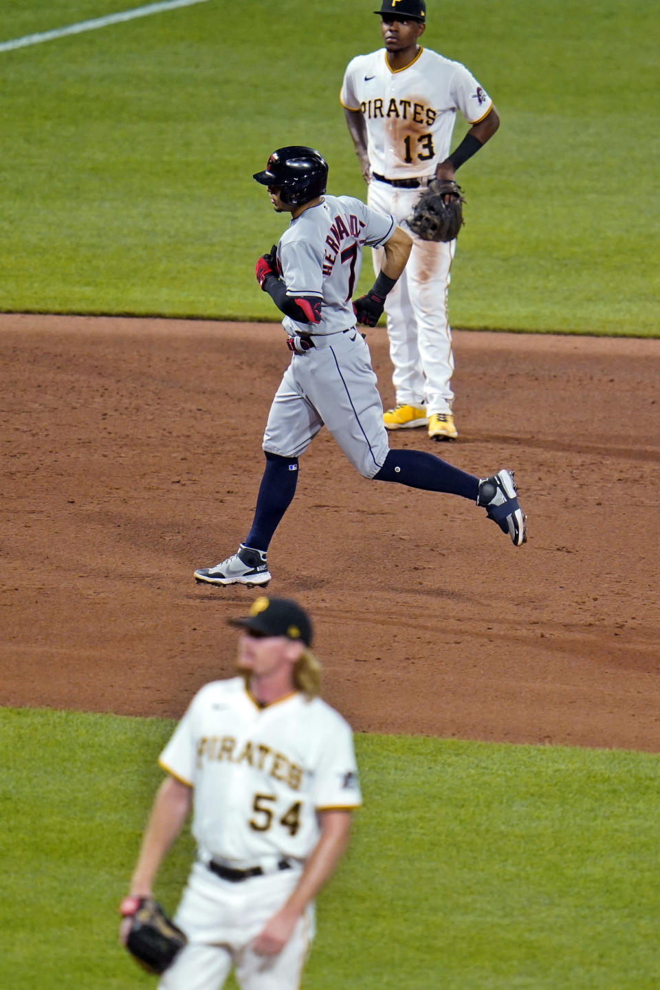 Cleveland Indians' Cesar Hernandez (7) runs the bases after hitting a grand slam off Pittsburgh Pirates relief pitcher Sam Howard (54) during the seventh inning of a baseball game in Pittsburgh, Friday, June 18, 2021. (AP Photo/Gene J. Puskar)