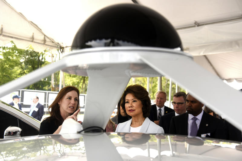 U.S. Transportation Secretary Elaine Chao, right, looks at the Lidar system with Jill Sciarappo, senior director, Intel Automated Driving Group, Tuesday, Sept. 12, 2017, at the University of Michigan, in Ann Arbor, Mich., where she announced new voluntary safety guidelines for self-driving cars during a visit to an autonomous vehicle testing facility at the school. The new guidelines update policies issued last fall by the Obama administration, which were also largely voluntary. (Max Ortiz/Detroit News via AP)