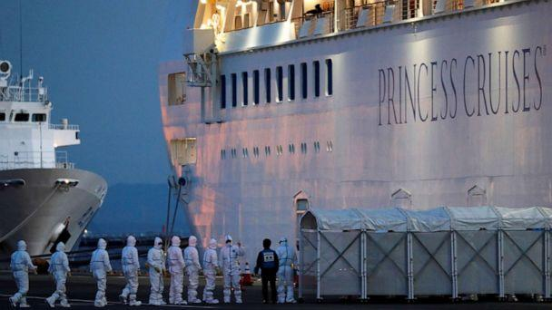 PHOTO: Officers in protective gear enter the Diamond Princess cruise ship to transfer a patient who tested positive for the novel coronavirus to the hospital after the ship arrived at Daikoku Pier Cruise Terminal in Yokohama, Japan, Feb. 7, 2020. (Kim Kyung Hoon/Reuters)