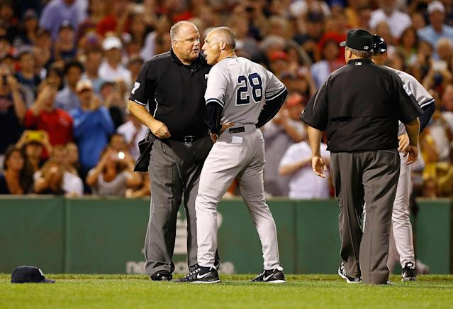 BOSTON, MA - AUGUST 18: Manager Joe Girardi #28 of the New York Yankees argues with home plate umpire Brian O'Nora after being ejected from the game following a warning of both benches in the second inning against the Boston Red Sox during the game on August 18, 2013 at Fenway Park in Boston, Massachusetts. (Photo by Jared Wickerham/Getty Images)