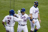 New York Mets' Michael Conforto (30) celebrates with teammates after hitting a two-run home run during the second inning of a baseball game against the Miami Marlins Saturday, Aug. 8, 2020, in New York. (AP Photo/Frank Franklin II)
