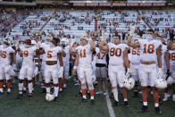 """Texas players, including Sam Ehlinger (11), sing """"The Eyes Of Texas"""" after an NCAA college football game against Baylor in Austin, Texas, Saturday, Oct. 24, 2020. (AP Photo/Chuck Burton)"""