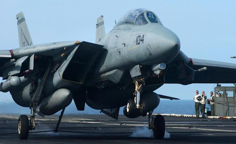 Atlantic Ocean (July 14, 2005) – Landing Signal Officers watch as an F-14B Tomcat, assigned to the