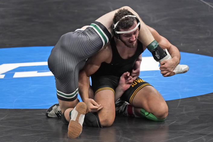 Iowa's Michael Kemerer, right, takes on Cal Poly's Bernie Truax during their 174-pound match in the semifinal round of the NCAA wrestling championships Friday, March 19, 2021, in St. Louis. (AP Photo/Jeff Roberson)