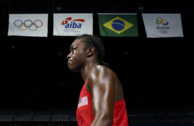 2016 Rio Olympics - Boxing - Final - Women's Middle (75kg) Final Bout 270 - Riocentro - Pavilion 6 - Rio de Janeiro, Brazil - 21/08/2016. Claressa Shields (USA) of USA walks under flags as she arrives for her bout. REUTERS/Peter Cziborra FOR EDITORIAL USE ONLY. NOT FOR SALE FOR MARKETING OR ADVERTISING CAMPAIGNS.