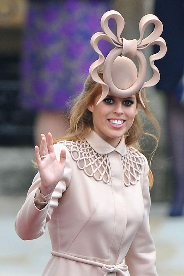 """<p>At the royal wedding of <a href=""""https://www.elledecor.com/life-culture/travel/news/g3239/travel-to-canada/"""" target=""""_blank"""">Prince William and Kate Middleton</a> in 2011, Will's cousin, Beatrice, wore the most talked-about hat of all. She paired her Valentino coat with an enormous taupe O with a bow on top. It garnered so much attention that she later sold it on <a href=""""https://www.ebay.com/"""" target=""""_blank"""">eBay</a> and raised $130,000 for charity. </p>"""