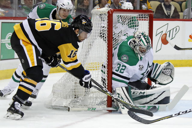 Dallas Stars goaltender Kari Lehtonen (32) blocks a wrap around shot by Pittsburgh Penguins' Josh Jooris (16) in the second period of an NHL hockey game in Pittsburgh, Sunday, March 11, 2018. (AP Photo/Gene J. Puskar)