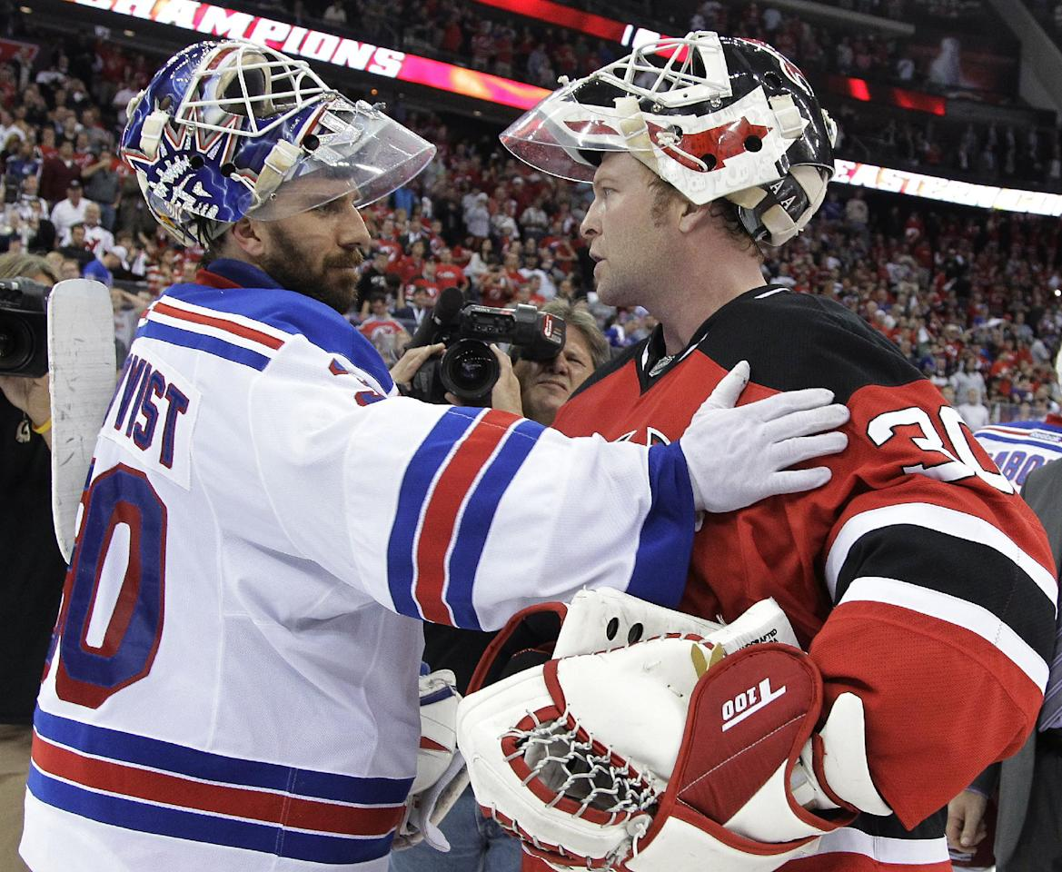 New Jersey Devils goalie Martin Brodeur, right, and New York Rangers goalie Henrik Lundqvist, of Sweden, talk after Game 6 of the NHL hockey Stanley Cup Eastern Conference finals, Friday, May 25, 2012, in Newark, N.J. The Devils won 3-2, and advanced to the Stanley Cup finals. (AP Photo/Julio Cortez)