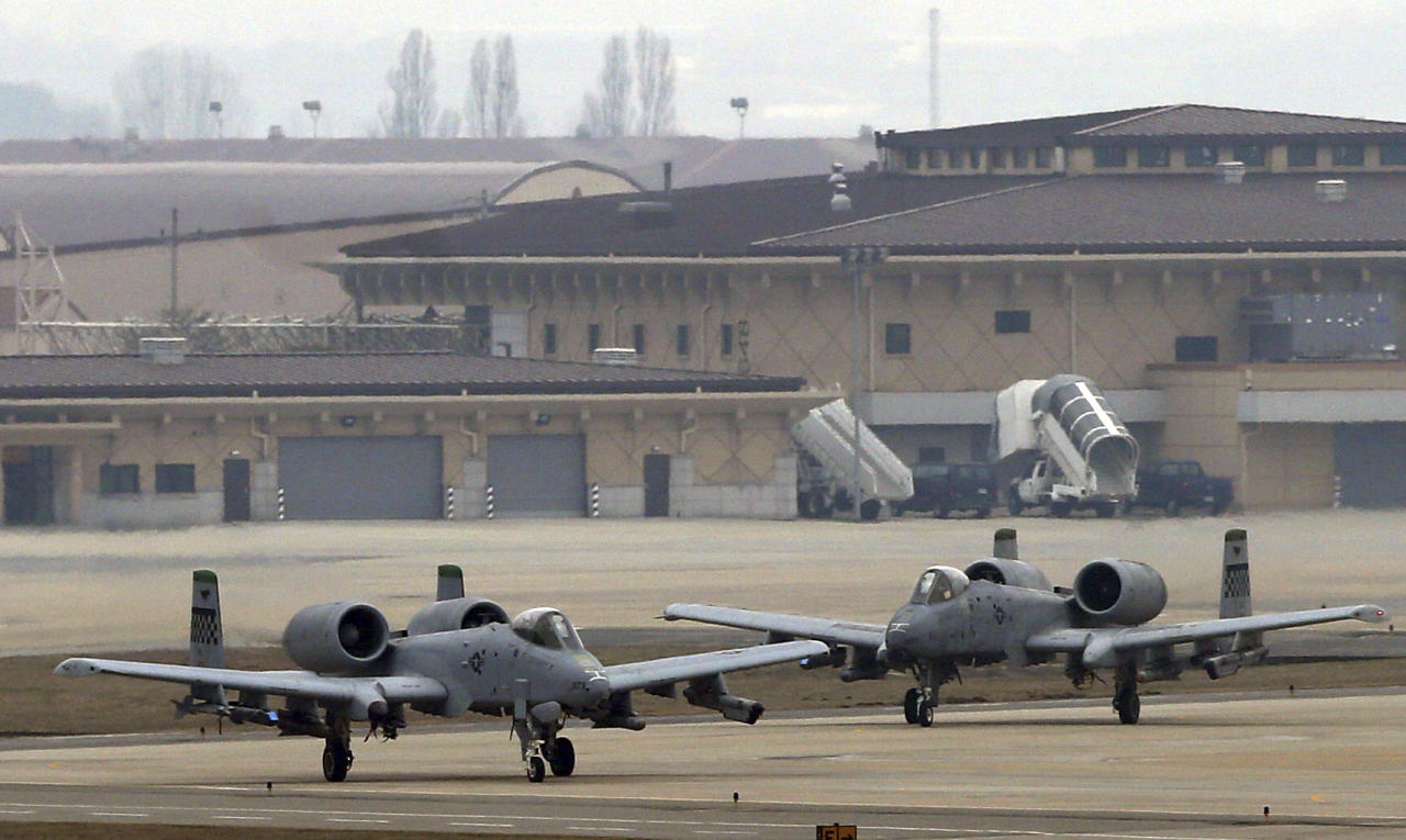 U.S. Air Force A-10 attack aircraft wait to take off on the runway during their military exercise at the Osan U.S. Air Base in Pyeongtaek, south of Seoul, South Korea, Tuesday, April 2, 2013. North Korea vowed Tuesday to restart a nuclear reactor that can make one bomb's worth of plutonium a year, escalating tensions already raised by near daily warlike threats against the United States and South Korea. (AP Photo/Bae Jung-hyun, Yonhap) KOREA OUT