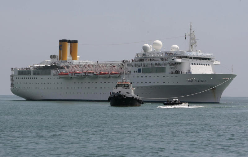 The Costa Allegra Cruise ship is towed in the Victoria's harbor, Seychelles Island, Thursday, March 1, 2012. The disabled cruise ship arrived in port in the island nation of the Seychelles on Thursday morning after three days at sea without power. (AP Photo/Gregorio Borgia)