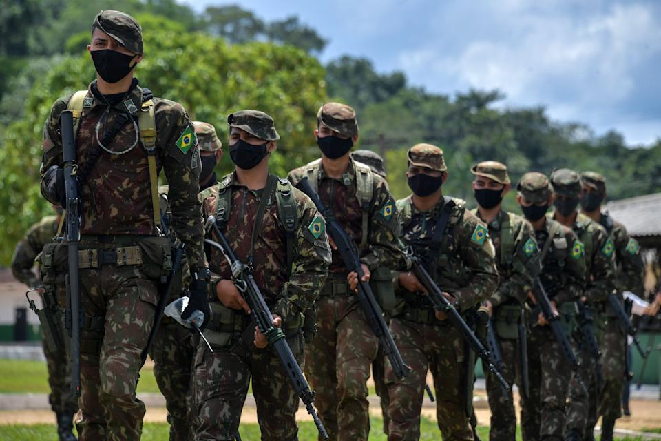 Members of the Brazilian Armed Forces take part in a military exercise as part of the Agata operation, on the Oiapoque River in Oiapoque, Amapa state, Brazil, on the border with French Guiana, on October 31, 2020. - The Agata operation carried out by the Armed Forces, Federal Police, Federal Revenue and the Brazilian Institute for the Environment and Renewable Natural Resources (IBAMA), consists in combating drug and arms trafficking, smuggling, illegal mining and fishing, boat theft and irregular transportation of wood and fuel, in the states of Para and Amapa. (Photo by NELSON ALMEIDA / AFP) (Photo by NELSON ALMEIDA/AFP via Getty Images)
