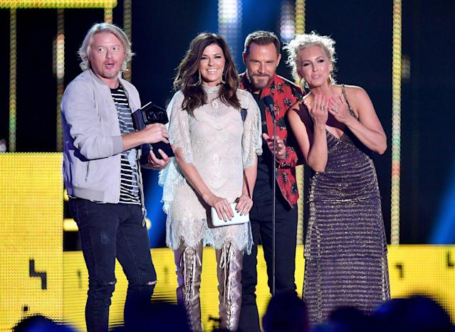 <p>(L-R) Philip Sweet, Karen Fairchild, Jimi Westbrook and Kimberly Schlapman of Little Big Town accept and award onstage during the 2017 CMT Music Awards at the Music City Center on June 7, 2017 in Nashville, Tennessee. (Photo by Jason Davis/WireImage) </p>