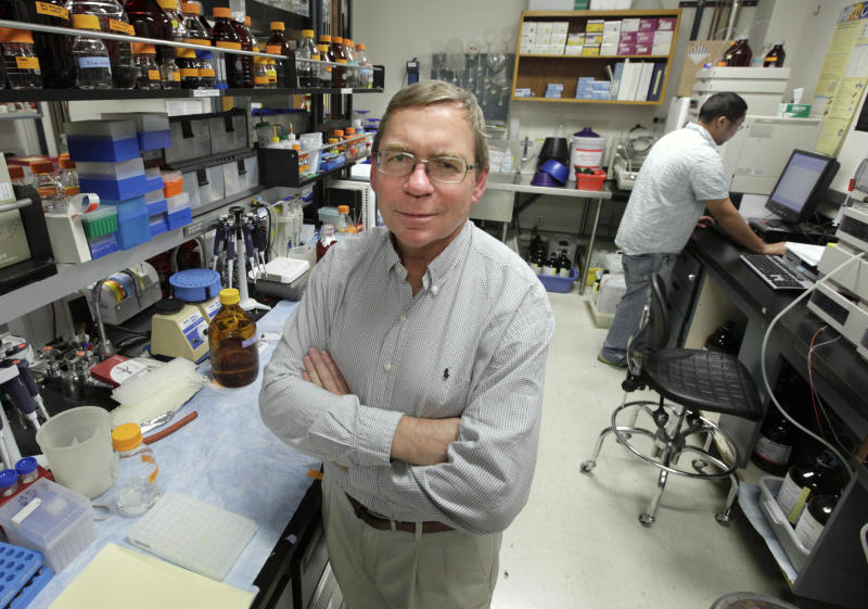 In this photo taken Friday, Dec. 22, 2012,  Carl Keen, who serves as chairman of the developmental nutrition program at the University of California, Davis, poses in one of the schools laboratories in Davis, Calif.  Keen, whose position is funded by the candy giant,  Mars Inc., said his laboratory's findings have pushed science forward through establishing that nutrients in cocoa powder can lower heart disease risk.(AP Photo/Rich Pedroncelli)