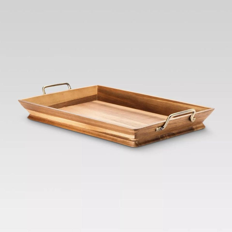 <p>Breakfast has never looked better than on this refined <span>Acacia Tray</span> ($37).</p>