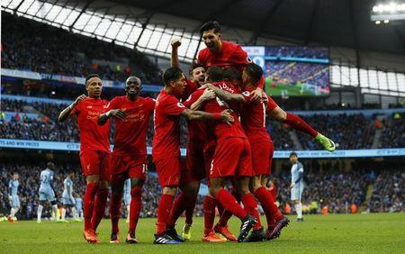 Liverpool's James Milner celebrates scoring their first goal with team mates