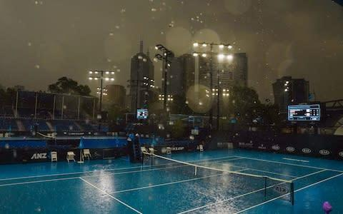 <span>Heavy rain falls during an Australian Open practice session at Melbourne Park in Melbourne, Australia, 15 January 2020.</span> <span>Credit: SCOTT BARBOUR/EPA-EFE/REX </span>