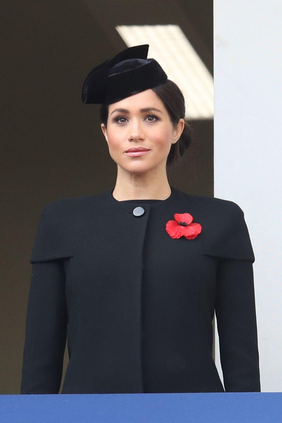 "<p>On Sunday, the royal family marked the <a href=""https://www.townandcountrymag.com/society/tradition/a24757664/prince-harry-field-of-remembrance-westminster-abbey-photos-2018/"" rel=""nofollow noopener"" target=""_blank"" data-ylk=""slk:Remembrance Day Service"" class=""link rapid-noclick-resp"">Remembrance Day Service</a> at the Cenotaph in London. The Duchess wore <a href=""https://www.townandcountrymag.com/style/fashion-trends/a24851110/meghan-markle-navy-blue-wwi-remembrance-service-photos/"" rel=""nofollow noopener"" target=""_blank"" data-ylk=""slk:a black coat and matching hat"" class=""link rapid-noclick-resp"">a black coat and matching hat</a> with a large poppy pin to the somber event.</p>"