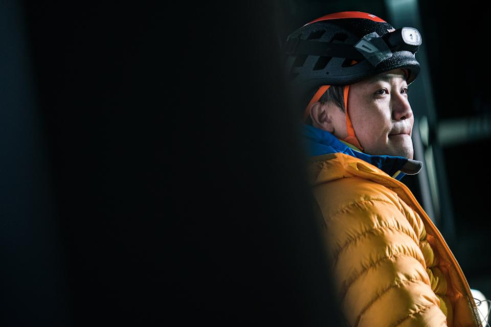 HONG KONG, CHINA - JANUARY 16: (EDITORIAL USE ONLY) Wheelchair Climber Lai Chi-wai reacts during the press conference after he completes 250-meter (75/f) out of 320-meter during his attempt to climb the 89-storey Nina Tower in Tsuen Wan by using only his upper body strength. The challenge raised over HK$5 million for spinal cord patients to utilize exoskeletons on January 16, 2021 at Nina Tower skyscraper, in Tsuen Wan, Hong Kong, China. (Photo by Lampson Yip - Clicks Images/Getty Images)