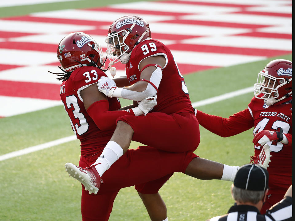 Fresno State defensive end Kwami Jones celebrates his sack against Hawaii with teammate Colby Warkentin during the first half of an NCAA college football game in Fresno, Calif., Saturday, Oct. 24, 2020. (AP Photo/Gary Kazanjian)