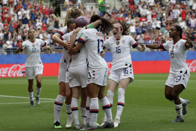 United States players celebrate after teammate Megan Rapinoe scoring the opening goal from a penalty kick during the Women's World Cup round of 16 soccer match between Spain and US at the Stade Auguste-Delaune in Reims, France, Monday, June 24, 2019. (AP Photo/Alessandra Tarantino)