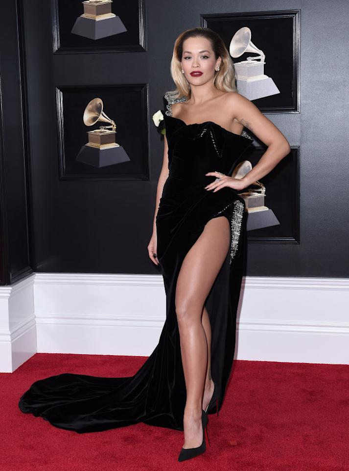 <p>Rita Ora demonstrated how to work the thigh-high split trend Hollywood's A-listers keep insisting on donning. The singer chose a cold-shoulder gown by Ralph and Russo and finished the look with a bold, wintry lip. <em>[Photo: Getty]</em> </p>