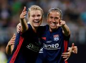 FILE PHOTO: Ada Hegerberg celebrates with team mate Camille Abily after Olympique Lyonnais' fourth goal against Vfl Wolfsburg in the Women's Champions League final.