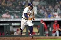 Houston Astros' Jose Altuve runs down the first base line after a bunt single against the Los Angeles Angels during the fourth inning of a baseball game Monday, May 10, 2021, in Houston. (AP Photo/David J. Phillip)