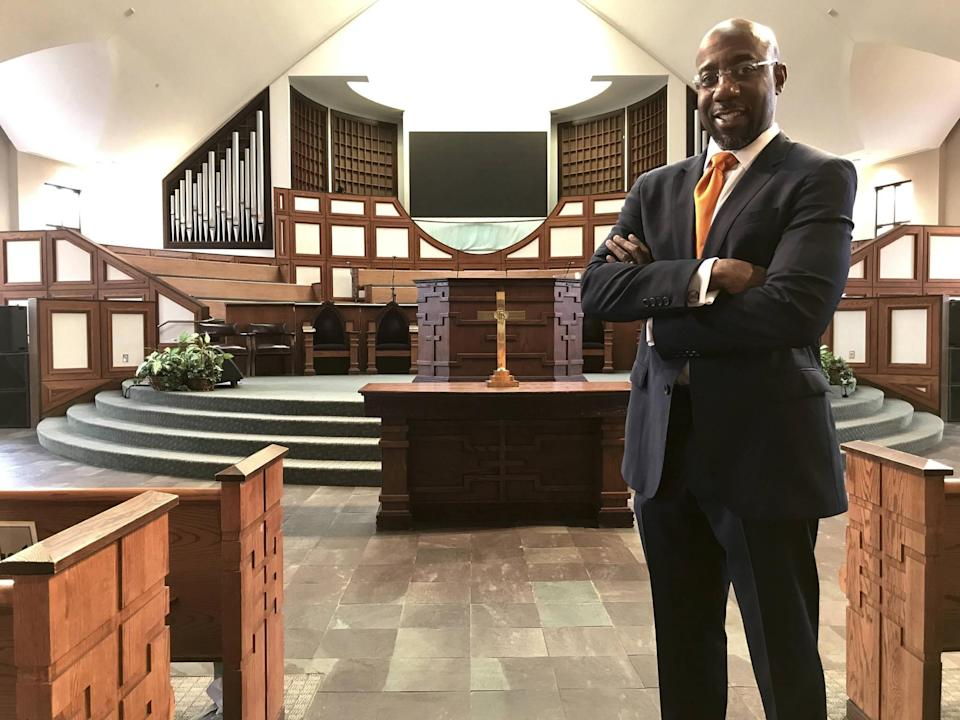FILE - In this Thursday, Jan. 11, 2018 photo, the Rev. Raphael Warnock stands in the sanctuary of Ebenezer Baptist Church in Atlanta. Warnock is senior pastor of the congregation once led by the Rev. Martin Luther King Jr.