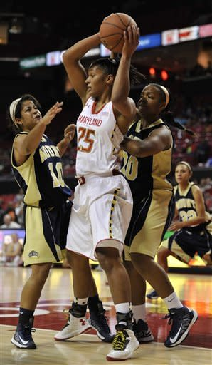 Maryland's Alyssa Thomas, center, is double teamed by Mount St. Mary's Selina Mann, left, and Kayla Grossett during the first half of an NCAA college basketball game Friday, Nov. 9, 2012 in College Park, Md. Maryland won 88-47.(AP Photo/Gail Burton)