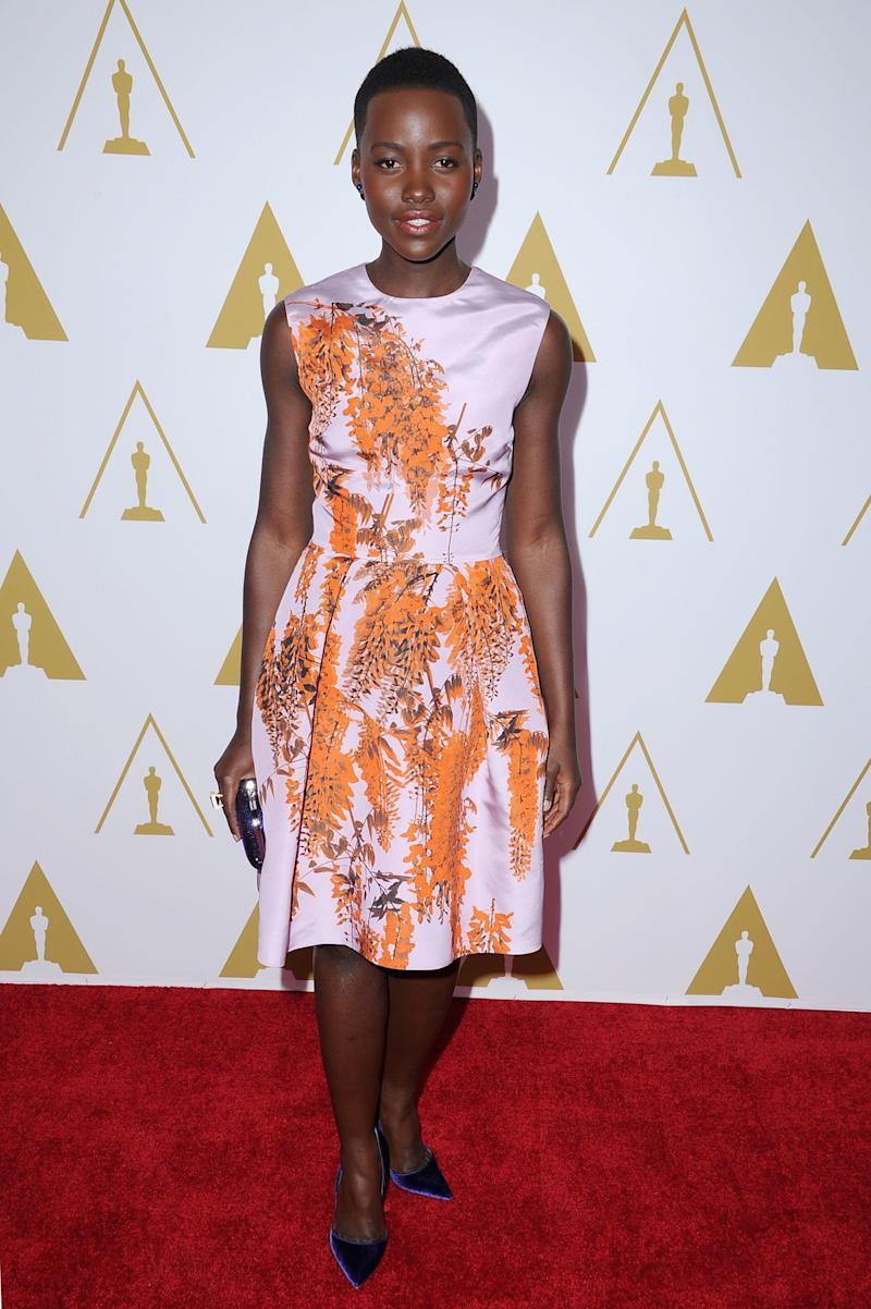 Nyong'o looked sweet at the Oscar Nominees Luncheon in a light pink, printed Dior dress and Paul Andrew blue velvet pumps. Mise en Dior blue pearl earrings (the trendiest accessory of the season) and a Judith Leiber clutch polished off the pretty look.