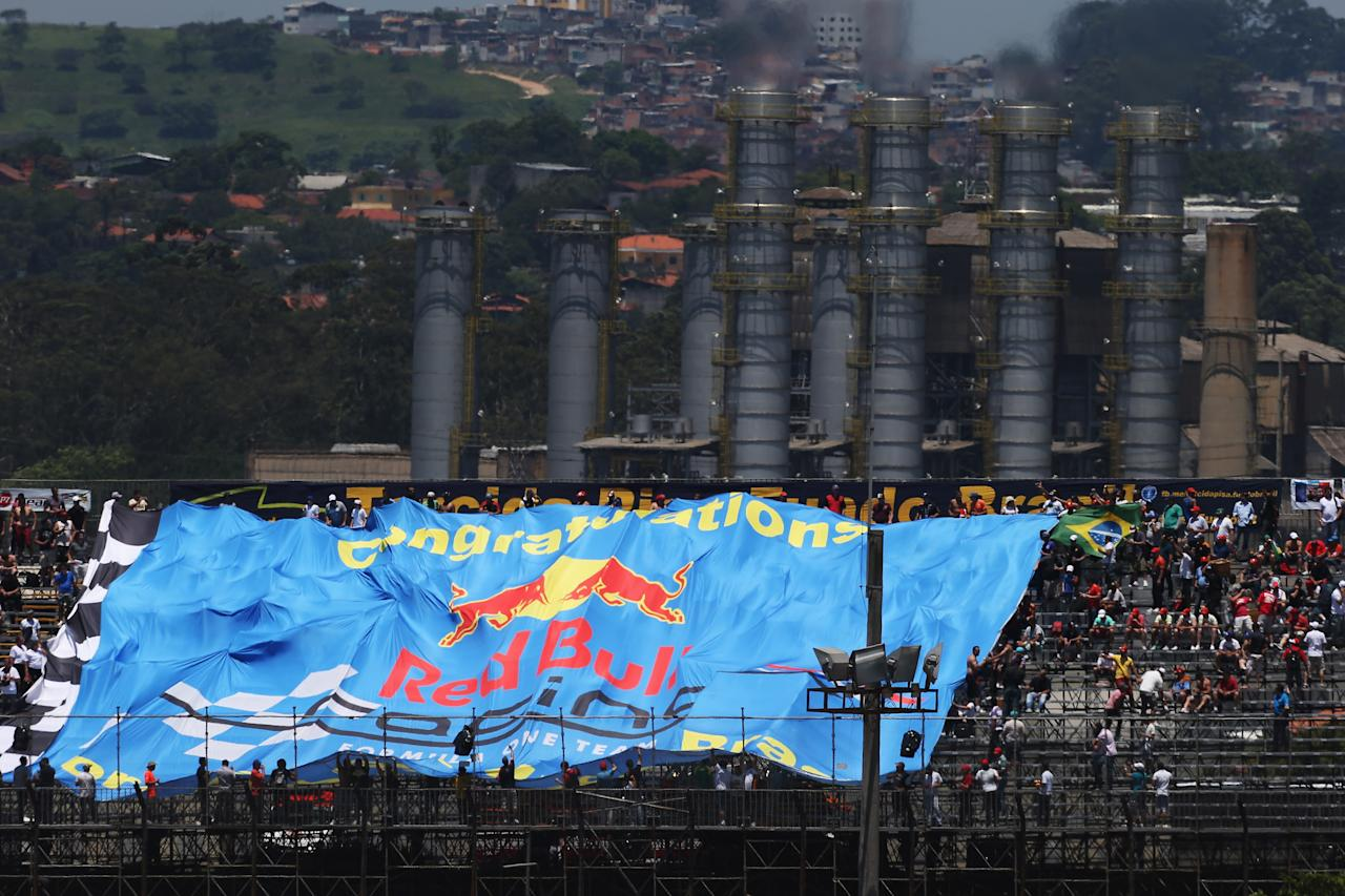 SAO PAULO, BRAZIL - NOVEMBER 23:  Red Bull Racing fans unfurl a giant flag during practice for the Brazilian Formula One Grand Prix at the Autodromo Jose Carlos Pace on November 23, 2012 in Sao Paulo, Brazil.  (Photo by Mark Thompson/Getty Images)