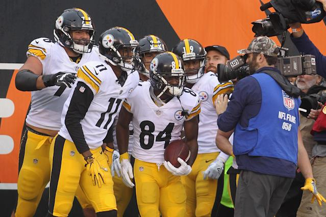 Antonio Brown celebrates with teammates for the cameras at an early season game. (Photo by John Grieshop/Getty Images)