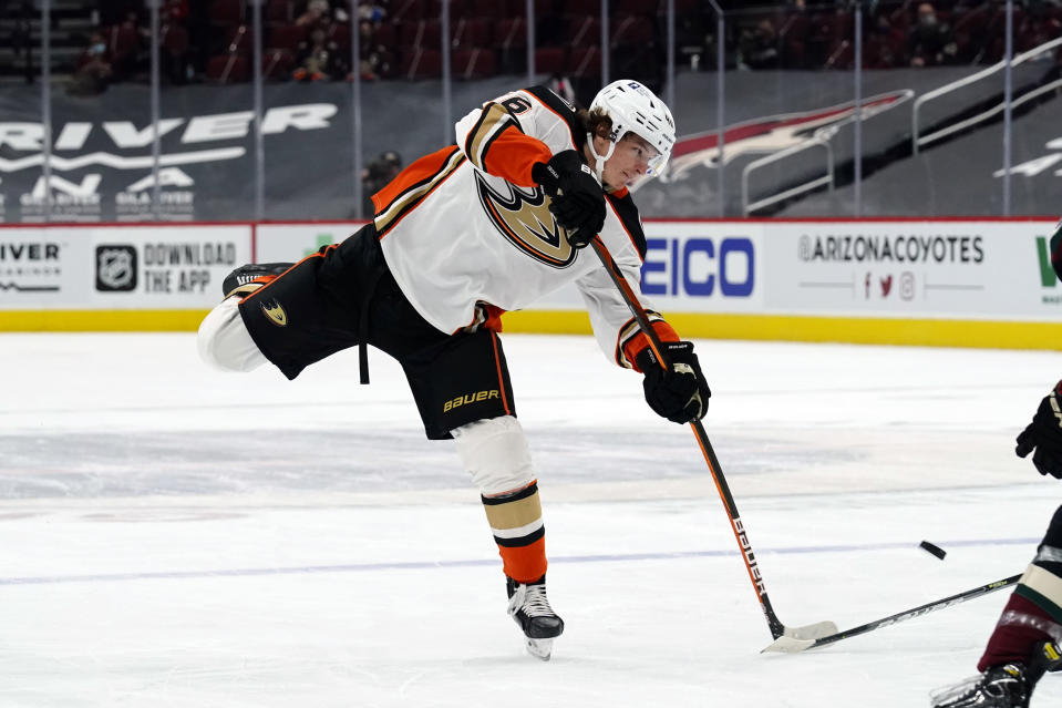 Anaheim Ducks center Trevor Zegras shoots on goal during the first period of the team's NHL hockey game against the Arizona Coyotes on Wednesday, Feb. 24, 2021, in Glendale, Ariz. (AP Photo/Rick Scuteri)