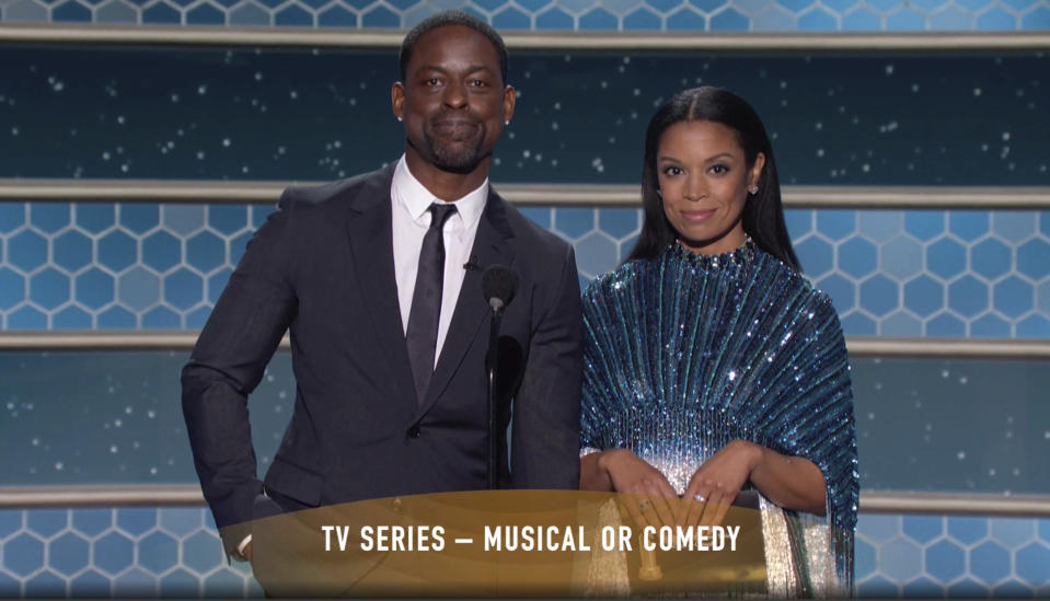 In this video grab issued Sunday, Feb. 28, 2021, by NBC, Sterling K. Brown, left, and Susan Kelechi Watson present the award for best television series, musical or comedy, at the Golden Globe Awards. (NBC via AP)