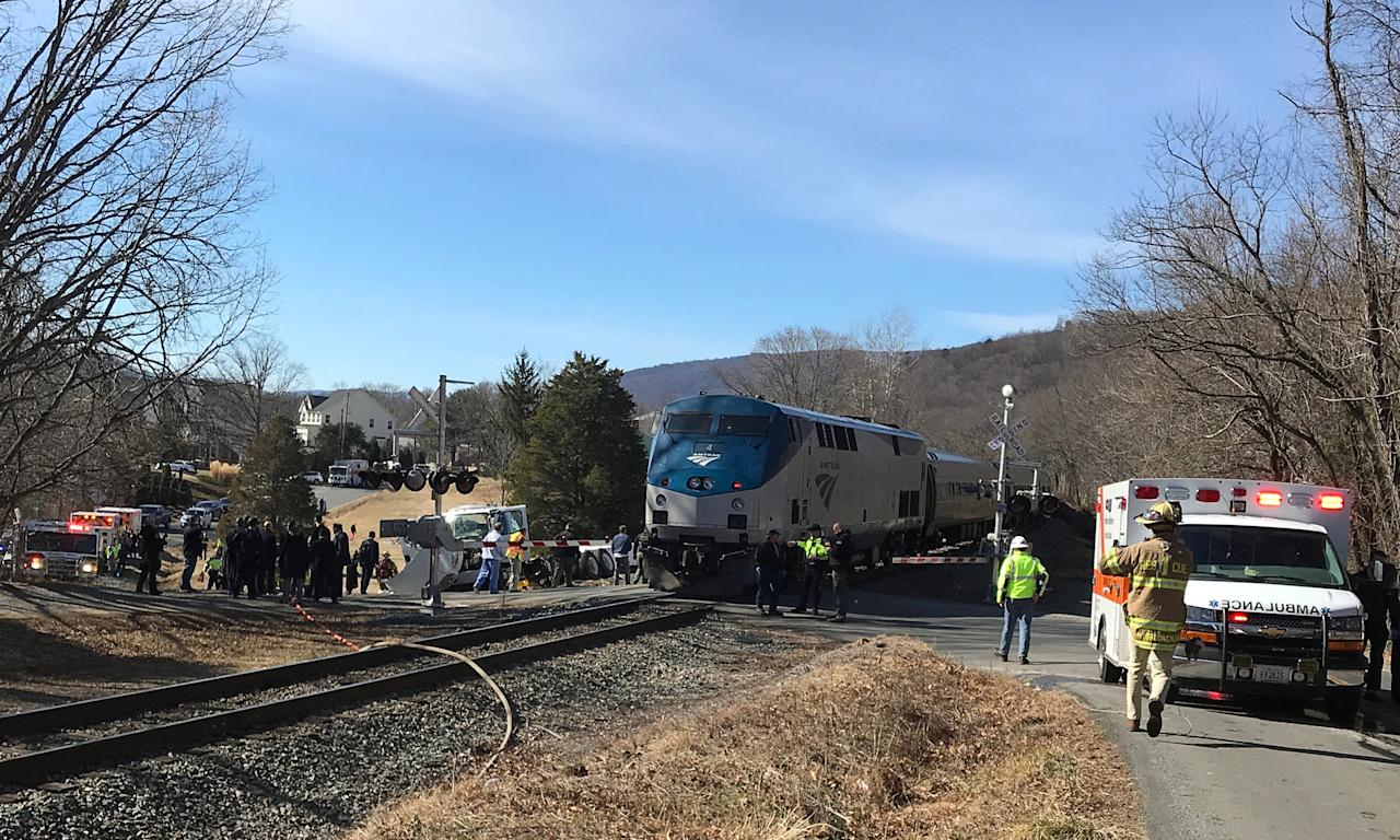 <p>Emergency first responders work at the scene of the crash where an Amtrak passenger train carrying Republican members of the U.S. Congress from Washington to a retreat in West Virginia collided with a garbage truck in Crozet, Va. on Jan. 31, 2018. (Photo: Justin Ide/Crozet Volunteer Fire Department/Reuters) </p>