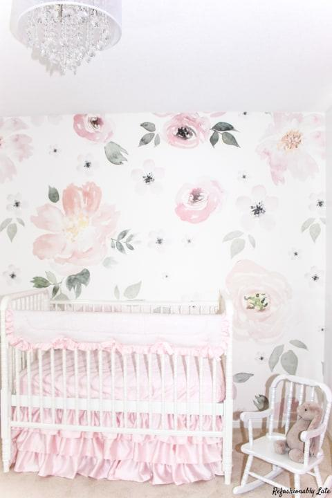 """An accent wall can make a nursery """"feel very chic, even if there is a crib and a ton of toys in the space."""""""