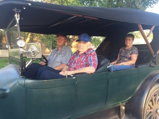 D.A. Crist, the unofficial historian of Gove County, Kansas, sits in the front seat of a right-hand drive 1915 Pierce Arrow car being driven by his son Dan, with Dan's wife Janice in the back seat, in this undated photo. D.A. Crist died of coronavirus Oct. 12, 2020.