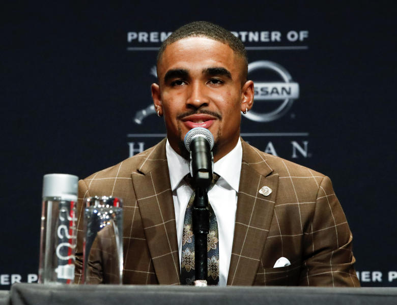 NCAA college football player and Heisman Trophy finalist, Oklahoma quarterback Jalen Hurts talks to the media during a news conference before the start of the Heisman Trophy ceremony, Saturday, Dec. 14, 2019, in New York. (AP Photo/Jason Szenes)