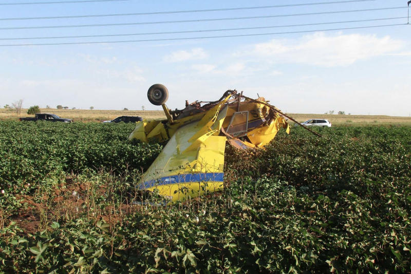 Wreckage of a crop-dusting plane that, according to safety officials, stalled after dumping hundreds of gallons of pink water as part of a gender reveal celebration. (Federal Aviation Administration via The New York Times)