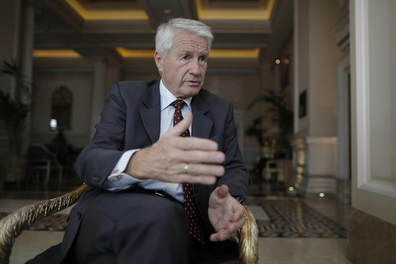 Thorbjoern Jagland, the head of the Council of Europe, speaks to The Associated Press in an interview at the start of his two-day visit to Athens, on Tuesday, Oct. 22, 2013. Greek lawmakers are to vote late Tuesday on a proposal to suspend state funding for political parties accused of criminal activities, a measure targeting the Nazi-inspired Golden Dawn group. (AP Photo/Petros Giannakouris)
