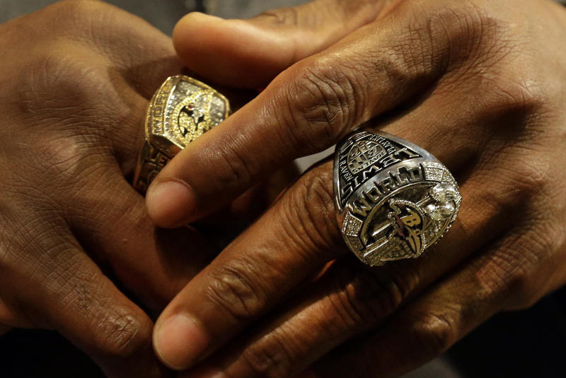 Former Baltimore Ravens linebacker Ray Lewis wears his Super Bowl XLVII championship ring, right, along with his Super Bowl XXXV ring, as he speaks at a news conference after receiving the ring at a ceremony at the team's NFL football practice facility in Owings Mills, Md., Friday, June 7, 2013. The Ravens defeated the San Francisco 49ers 34-31 to win their second franchise Super Bowl. (AP Photo/Patrick Semansky)