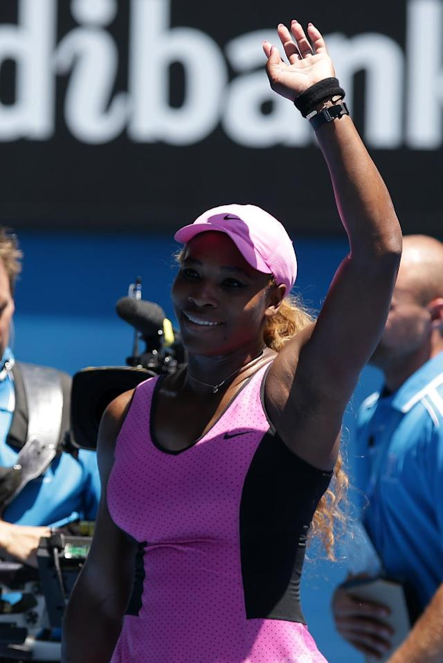 Serena Williams of the U.S. celebrates after defeating Daniela Hantuchova of Slovakia in their third round match at the Australian Open tennis championship in Melbourne, Australia, Friday, Jan. 17, 2014.(AP Photo/Aaron Favila)