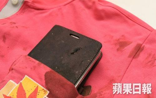 Smartphone in a bloodied shirt pocket