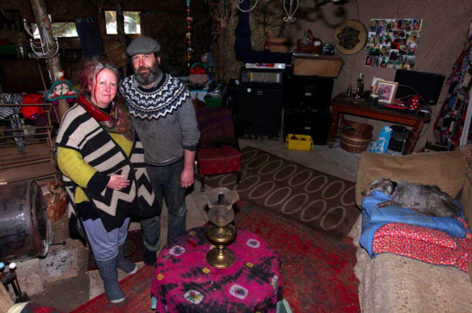 <em>Kate Burrows and partner Alan claim to have been bullied out of their mud hut (SWNS)</em>